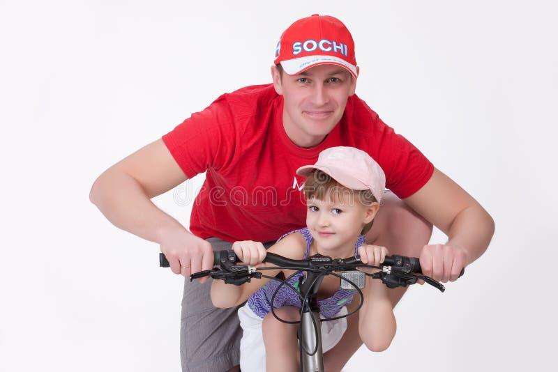 Vader en Dochter op de Fiets stock foto