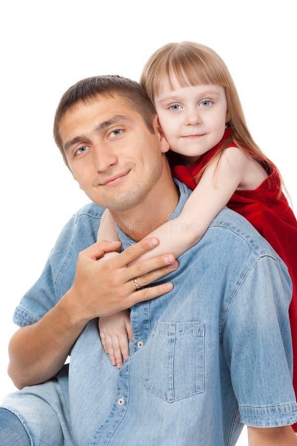 Vader en jonge dochterzitting op de vloer royalty-vrije stock foto