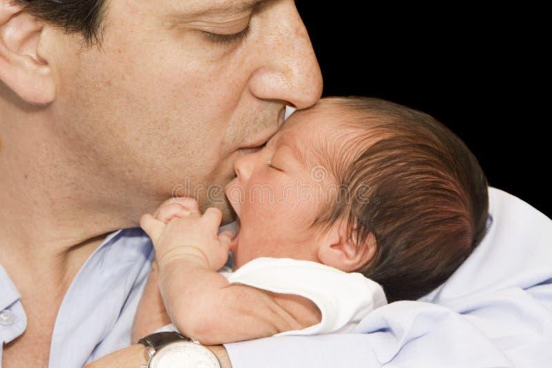 Vader en Pasgeboren baby stock foto