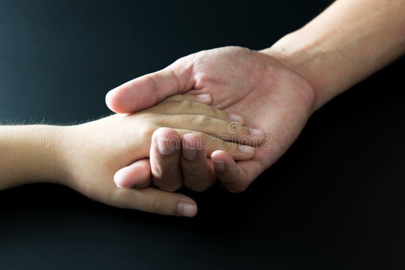 Vader en van het kind hand royalty-vrije stock foto