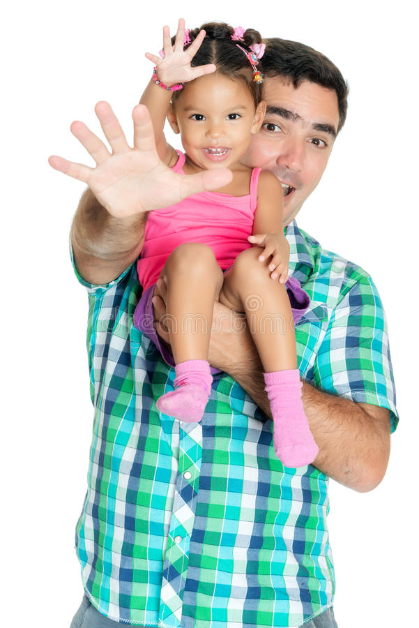 Vader en zijn kleine dochter die hun handen golven royalty-vrije stock foto