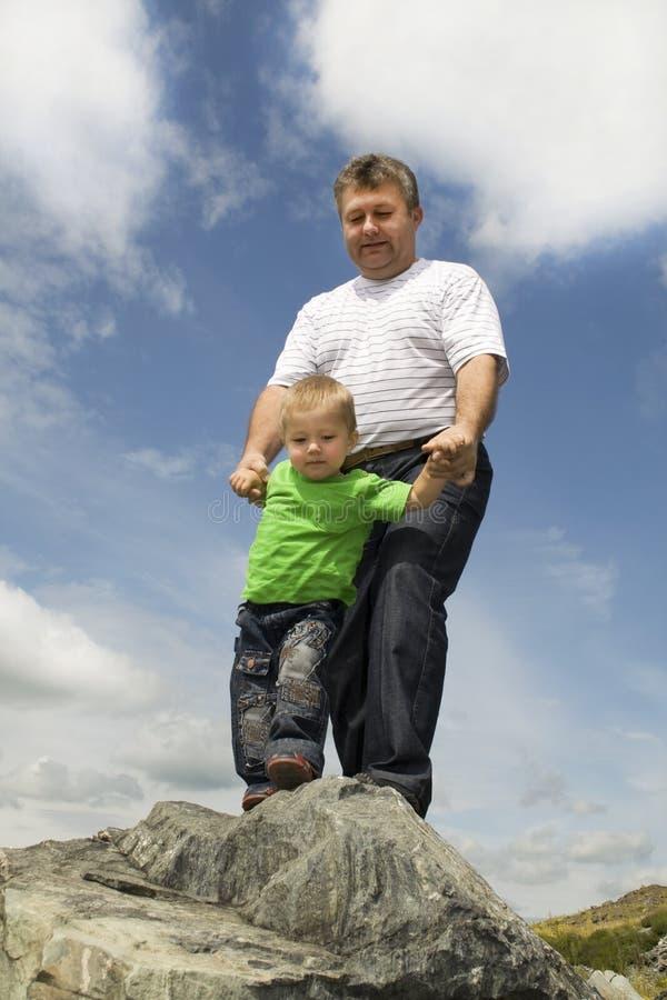 Vader en Zoon - uiterste. stock foto