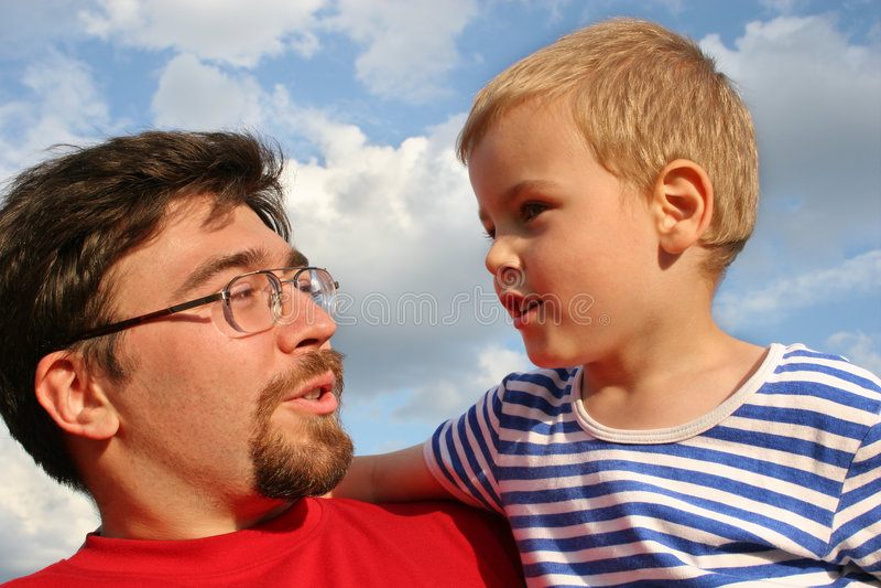 Vader met zoon stock afbeelding