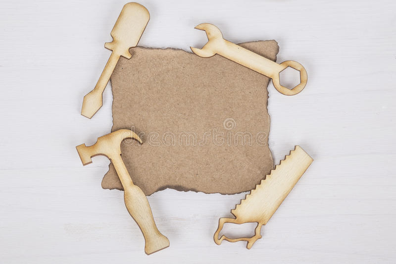 Vaderdagmalplaatje met houten tol stock afbeeldingen