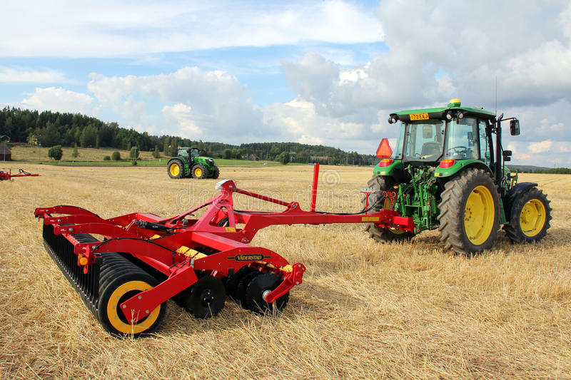 Vaderstad cultivator and John Deere Tractor royalty free stock photos