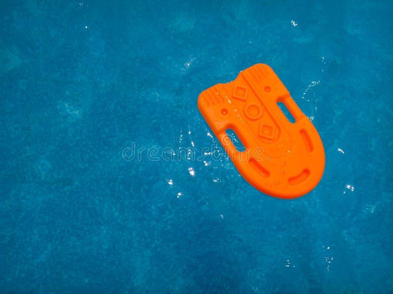 Vagabundo da laranja da piscina fotografia de stock