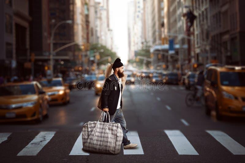 Vagabundo en la calle fotografía de archivo libre de regalías