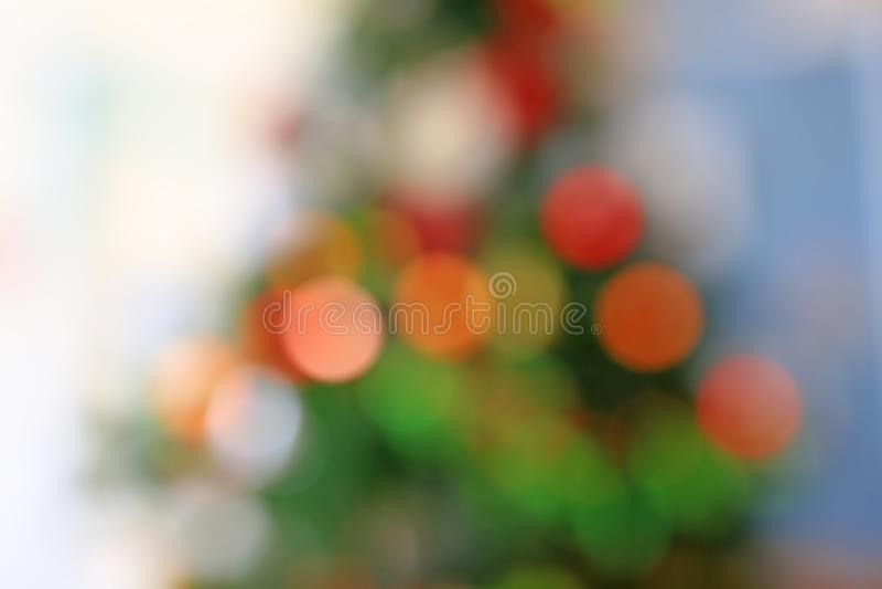 Vage kleurrijke bokehlichten op Kerstboomachtergrond royalty-vrije stock foto