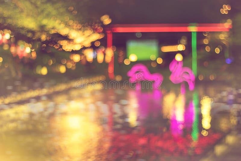 Vage nacht lichte achtergrond van festival met kleurrijke lichte decoratie royalty-vrije stock afbeelding