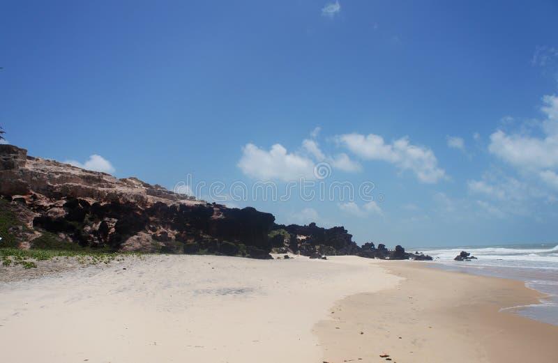 Vagga stranden arkivfoto