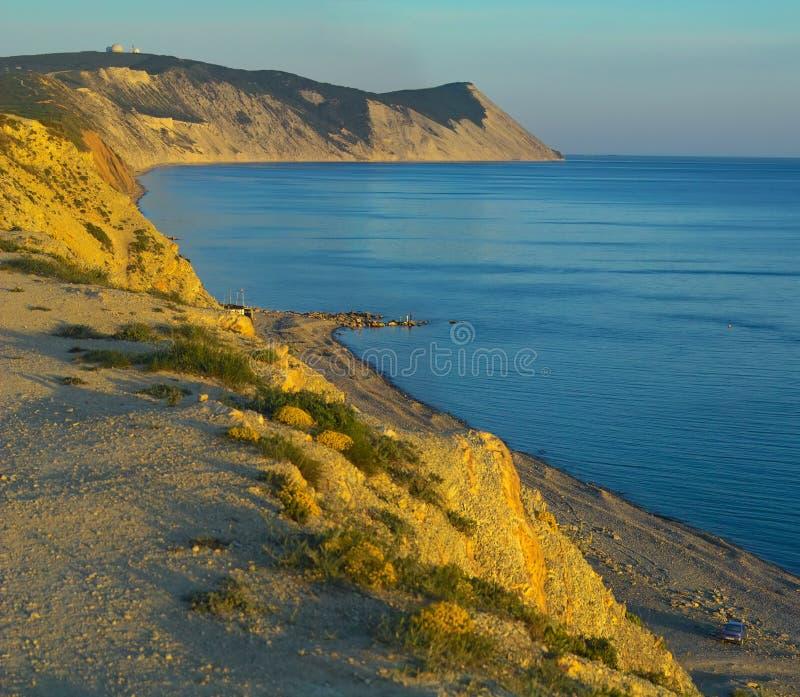 Download Vaggar havssolnedgång arkivfoto. Bild av semester, sand - 235378