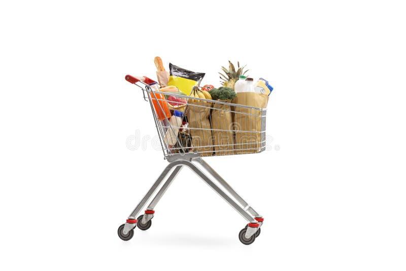 vagnen fyllde att shoppa för livsmedel arkivfoton