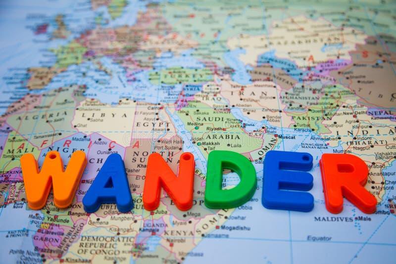 vague escrito con los bloques del juguete en un mapa del mundo imágenes de archivo libres de regalías
