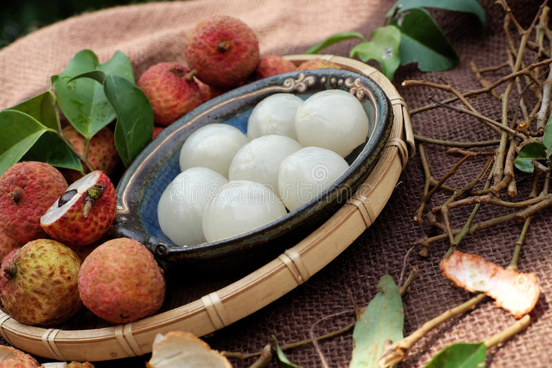 Vai thieu Vietnam, lychee fruits. Close up of litchi fruit or lychee fruits, a tropical agriculture product at Luc Ngan, Bac Giang, Vietnam, basket of Vai thieu stock photo