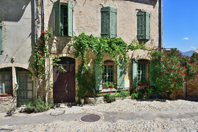 Vaison la Romaine, Provence, France. France, Provence. Vaison la Romaine. Typical medieval houses decorated with green plant and flowers in pots stock photos
