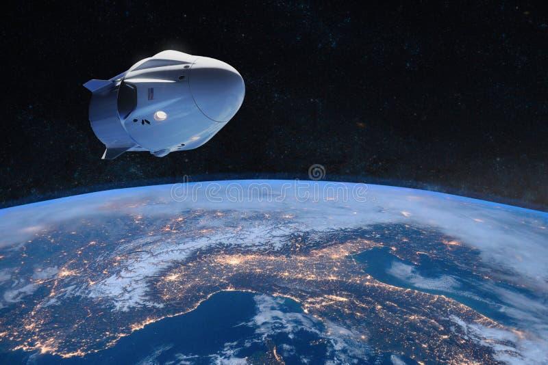 Vaisseau spatial de cargaison dans l'orbite de la bas-terre ?l?ments de cette image meubl?s par la NASA illustration libre de droits