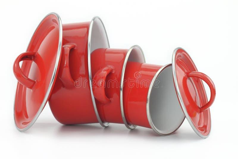 Vaisselle de cuisine rouge d'acier inoxydable photos libres de droits