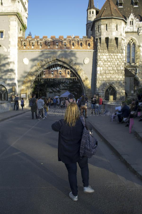 Tourists take photos of Vajdahunyad Castle in Hungary in Budapest. stock images