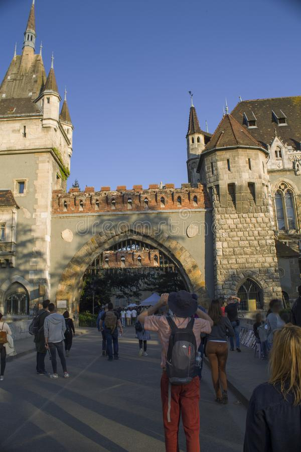 Tourists take photos of Vajdahunyad Castle in Hungary in Budapest. stock photography