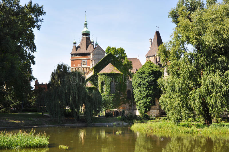 Vajdahunyad Castle with lake over royalty free stock photo