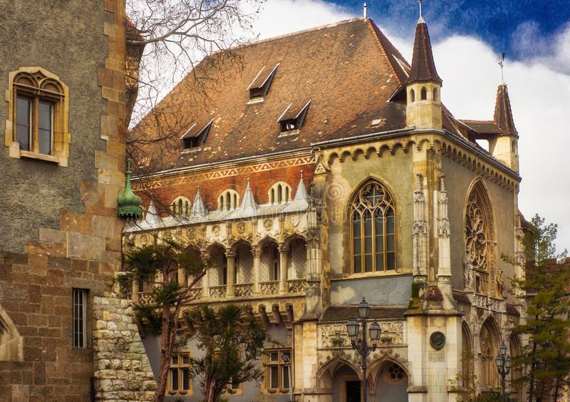 Vajdahunyad Castle. Is one of the romantic castles in Budapest, Hungary, located in the City Park by the boating lake / skating rink. The castle, despite all royalty free stock photo