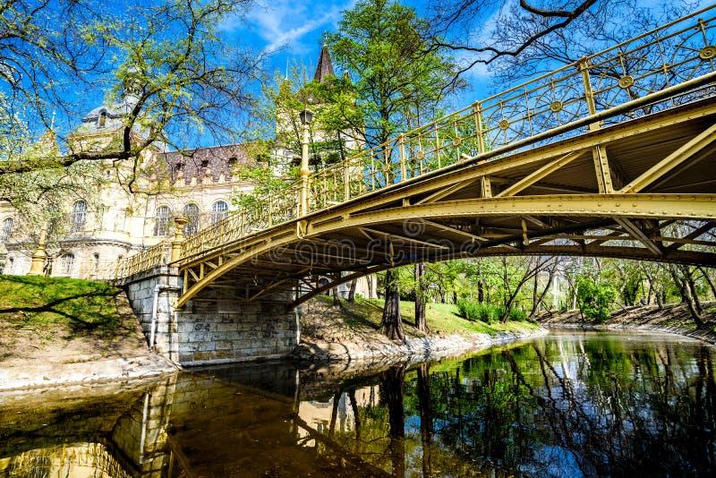 The Vajdahunyad castle in the Varosliget park. Gatehouse tower, bridge above the creek stock photos