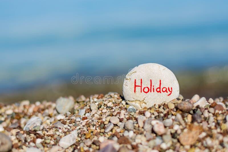 Vakantie die op een steen schrijven royalty-vrije stock foto's