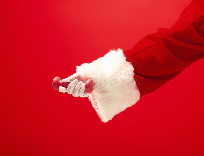 Vakantie en vieringen, Nieuw jaar, Kerstmis, sporten, het bodybuilding, gezonde levensstijl royalty-vrije stock afbeelding