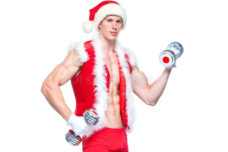 Vakantie en vieringen, Nieuw jaar, Kerstmis, sporten, het bodybuilding, gezonde levensstijl - Spier knappe Santa Claus stock afbeeldingen