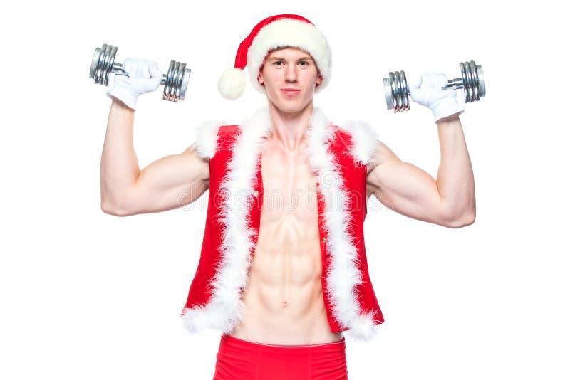 Vakantie en vieringen, Nieuw jaar, Kerstmis, sporten, het bodybuilding, gezonde levensstijl - Spier knappe Santa Claus royalty-vrije stock afbeeldingen