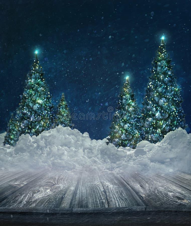 Vakantieachtergrond met Kerstbomen in sneeuw stock foto