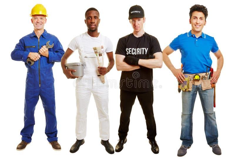 Vaklieden als groep voor een bouwwerf stock afbeelding