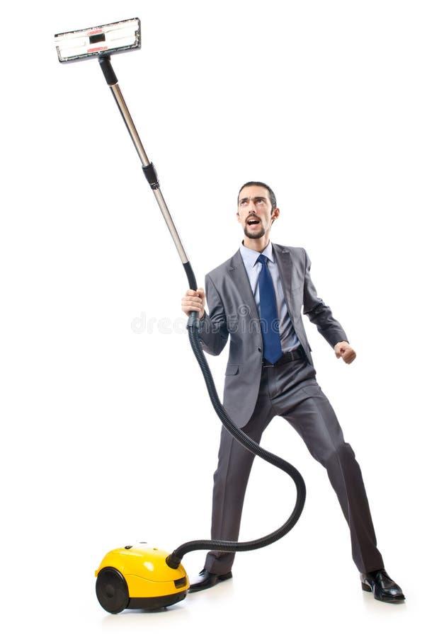 Vakuumreinigung durch Geschäftsmann stockfotos