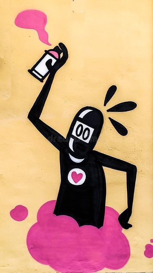 Valência, Espanha - em janeiro de 2019: Grafittis originais coloridos na parede de uma construção, desenho da rua, grande fundo e fotos de stock royalty free