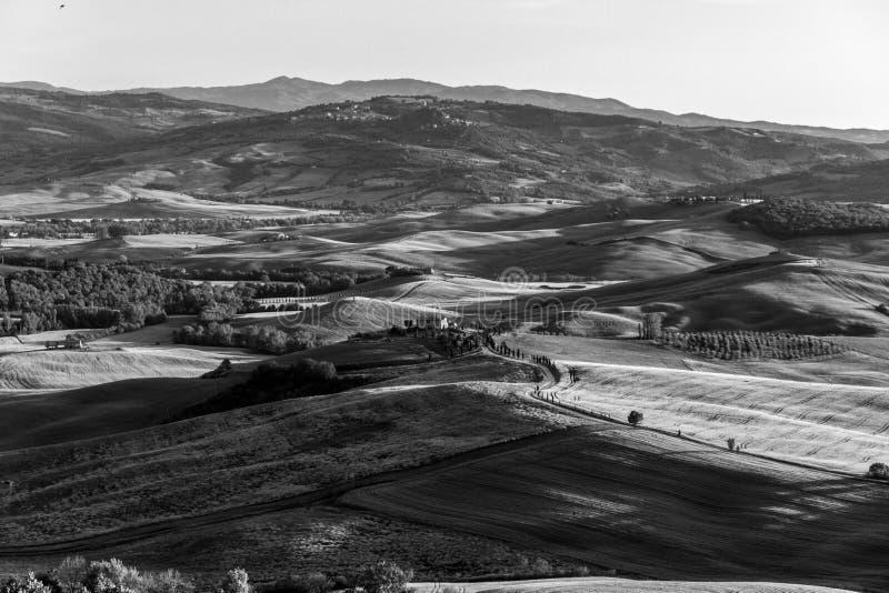Val D ` Orcia的一个意想不到的看法在日落的从皮恩扎 免版税图库摄影