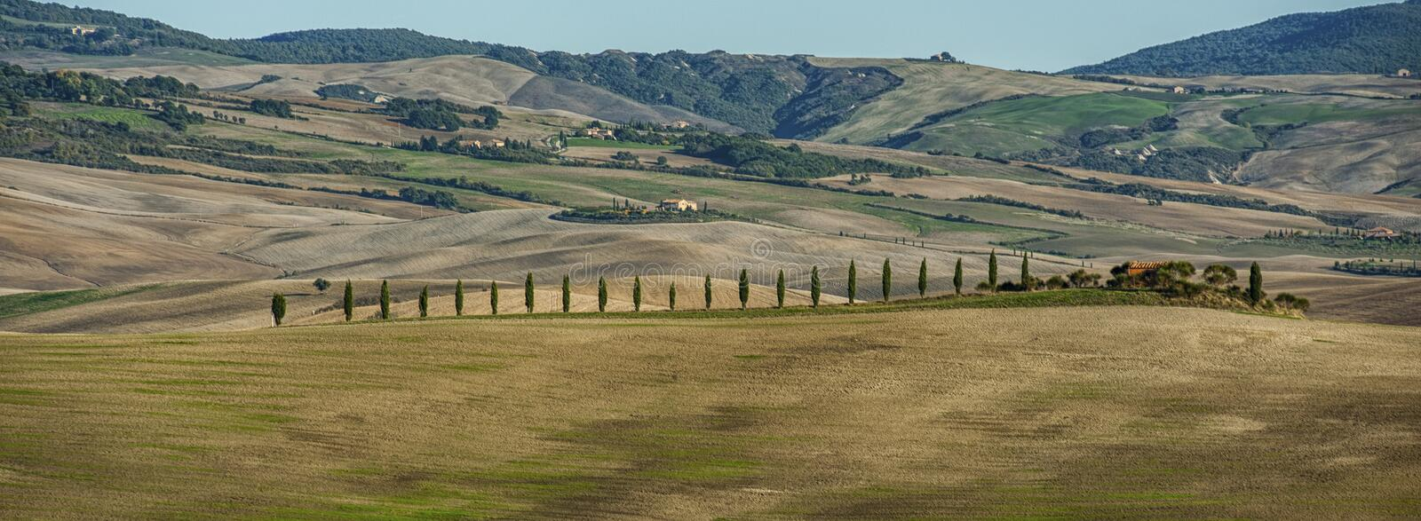 VAL D`ORCIA, TUSCANY-ITALY, OCTOBER 30, 2016: Scenic Tuscany landscape with rolling hills and valleys in autumn. Val D`Orcia, Italy stock image