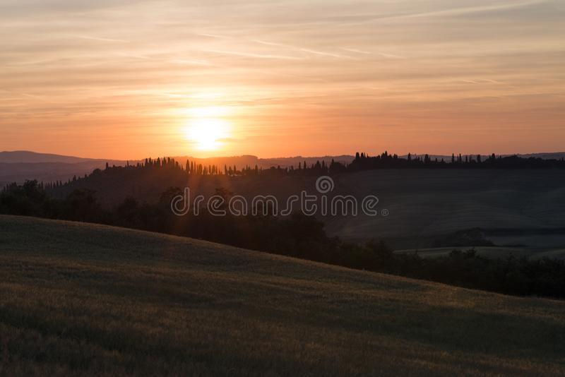 Val d`Orcia or Valdorcia landscape in Tuscany at sunset, a popular travel destination in Italy. Val d`Orcia or Valdorcia landscape in Tuscany at sunset, a very royalty free stock image