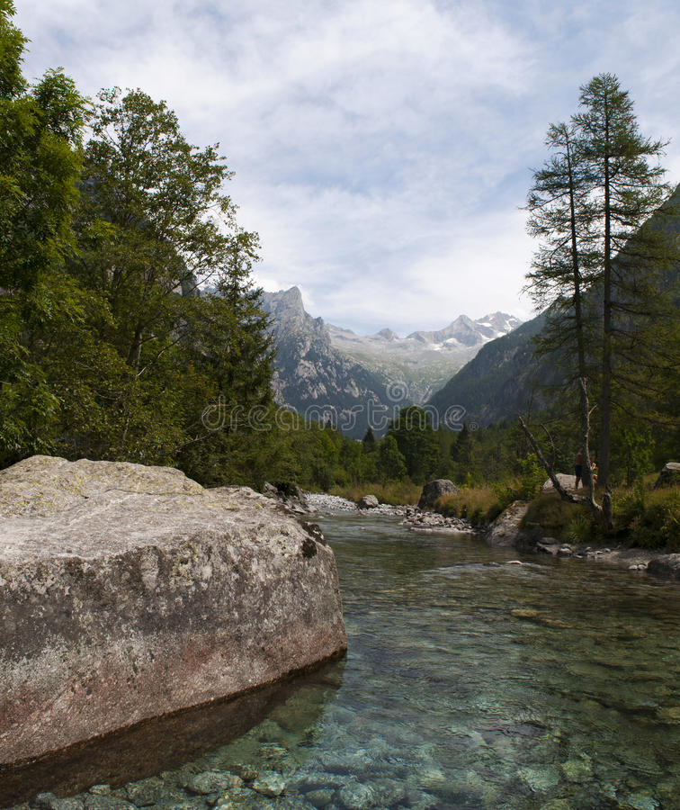 Val di Mello, Val Masino, Valtellina, Sondrio, Italy, Europe. Italy, 03/08/2017: creek and rocks of the Mello Valley, Val di Mello, a green valley surrounded by stock images