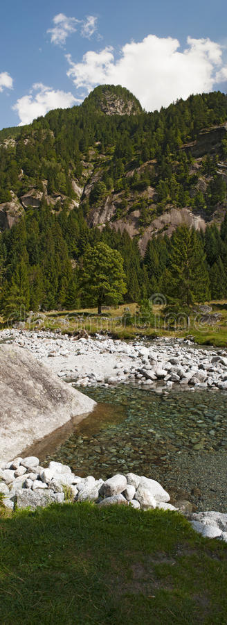Val di Mello, Val Masino, Valtellina, Sondrio, Italy, Europe. Italy, 03/08/2017: creek and rocks of the Mello Valley, Val di Mello, a green valley surrounded by royalty free stock image