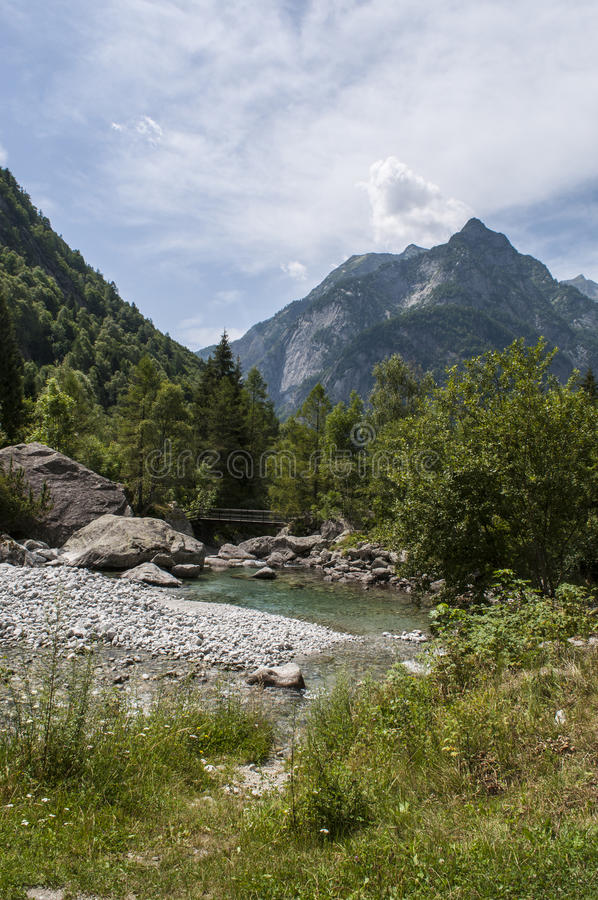 Val di Mello, Val Masino, Valtellina, Sondrio, Italy, Europe. Italy, 03/08/2017: creek and rocks of the Mello Valley, Val di Mello, a green valley surrounded by royalty free stock photos