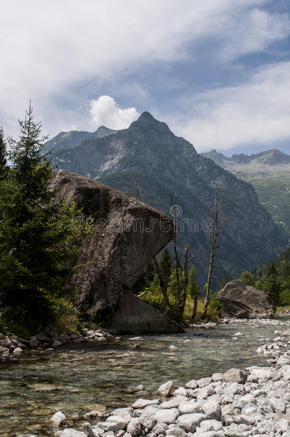 Val di Mello, Val Masino, Valtellina, Sondrio, Italy, Europe. Italy, 03/08/2017: creek and rocks of the Mello Valley, Val di Mello, a green valley surrounded by royalty free stock photo