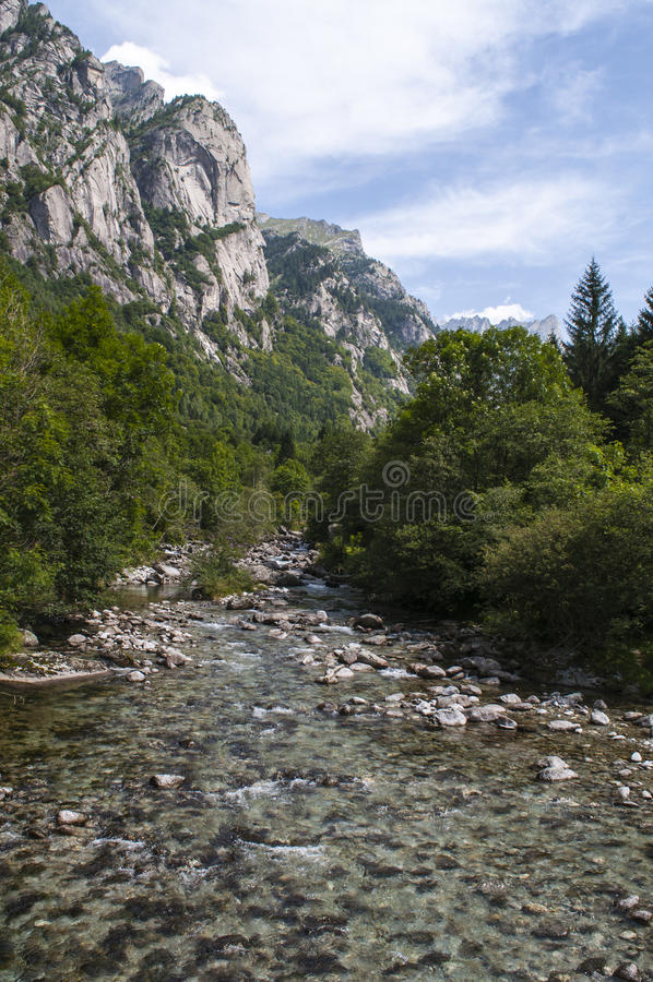Val di Mello, Val Masino, Valtellina, Sondrio, Italy, Europe. Italy, 03/08/2017: creek and rocks of the Mello Valley, Val di Mello, a green valley surrounded by royalty free stock images