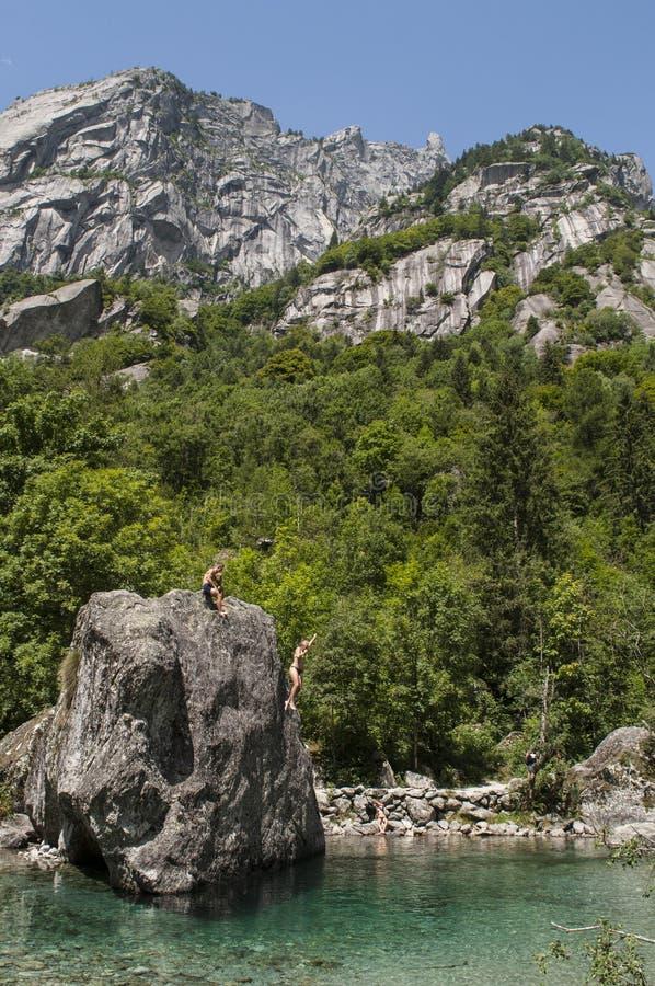 Val di Mello, Val Masino, Valtellina, Sondrio, Italy, Europe. Italy, 03/08/2017: dips from a rock called the Bidet of the Countess in Val di Mello, green valley stock photos