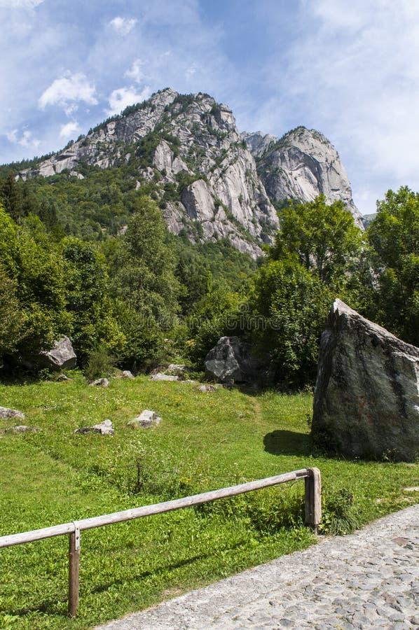Val di Mello, Val Masino, Valtellina, Sondrio, Italy, Europe. Italy, 03/08/2017: mountain peaks of the Mello Valley, Val di Mello, a green valley surrounded by royalty free stock image