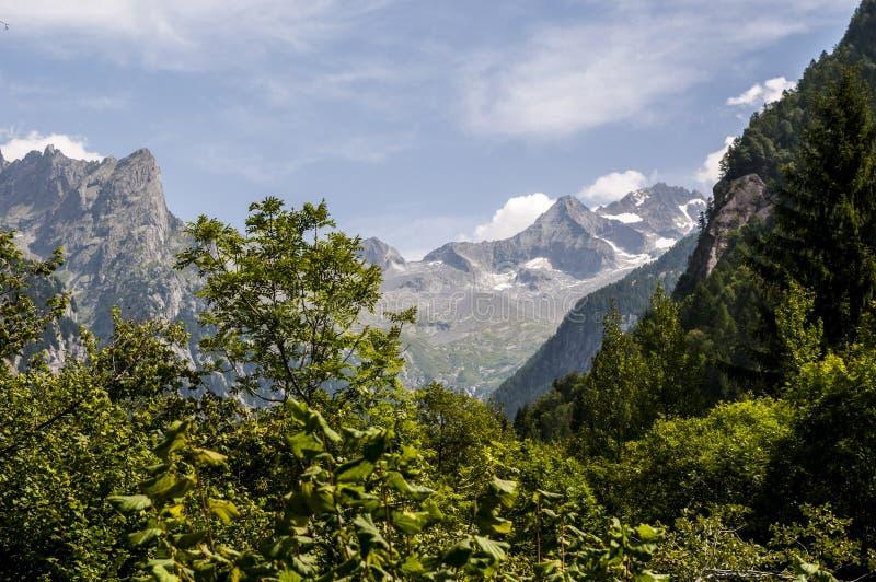 Val di Mello, Val Masino, Valtellina, Sondrio, Italy, Europe. Italy, 03/08/2017: mountain peaks of the Mello Valley, Val di Mello, a green valley surrounded by royalty free stock photography