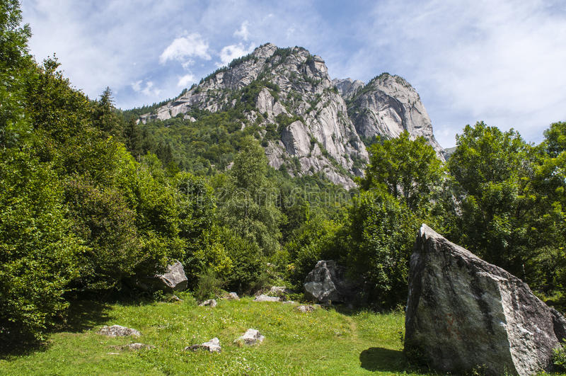Val di Mello, Val Masino, Valtellina, Sondrio, Italy, Europe. Italy, 03/08/2017: mountain peaks of the Mello Valley, Val di Mello, a green valley surrounded by royalty free stock images