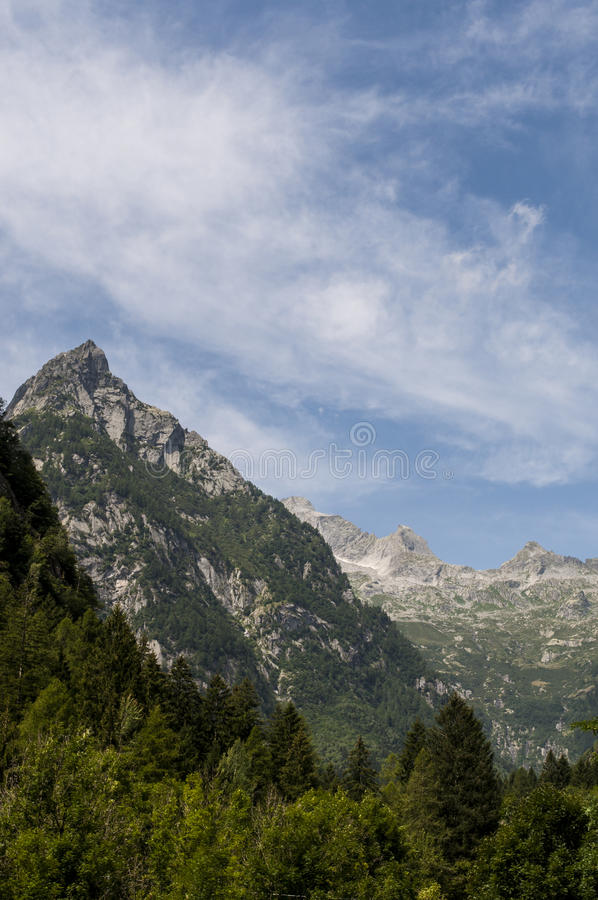 Val di Mello, Val Masino, Valtellina, Sondrio, Italy, Europe. Italy, 03/08/2017: mountain peaks of the Mello Valley, Val di Mello, a green valley surrounded by royalty free stock photography