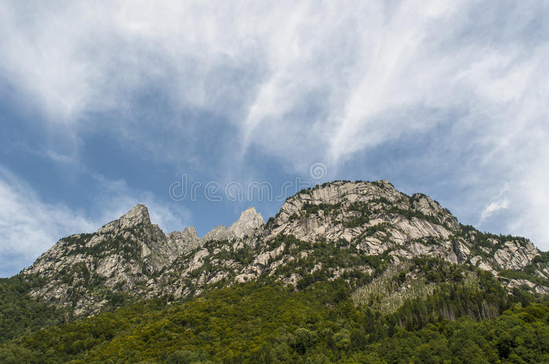 Val di Mello, Val Masino, Valtellina, Sondrio, Italy, Europe. Italy, 03/08/2017: mountain peaks of the Mello Valley, Val di Mello, a green valley surrounded by royalty free stock photo