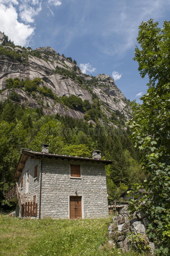 Val di Mello, Val Masino, Valtellina, Sondrio, Italy, Europe. Italy, 03/08/2017: mountain retreat in the Mello Valley, Val di Mello, a green valley surrounded by royalty free stock photos