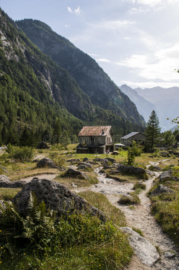 Val di Mello, Val Masino, Valtellina, Sondrio, Italy, Europe. Italy, 03/08/2017: mountain retreat in the Mello Valley, Val di Mello, a green valley surrounded by stock photo
